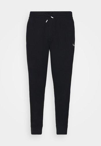 ESSENTIAL TAPE PANT - Pantaloni sportivi - black