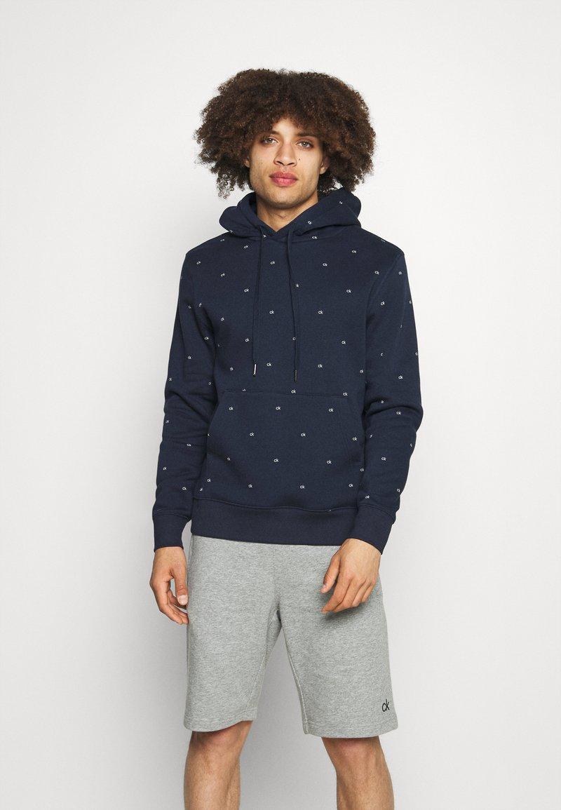 Calvin Klein Golf - ALL OVER PRINT HOODIE - Sweatshirt - navy