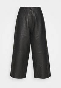 CELICE - Leather trousers - black