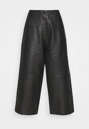 CELICE - Kožené kalhoty - black
