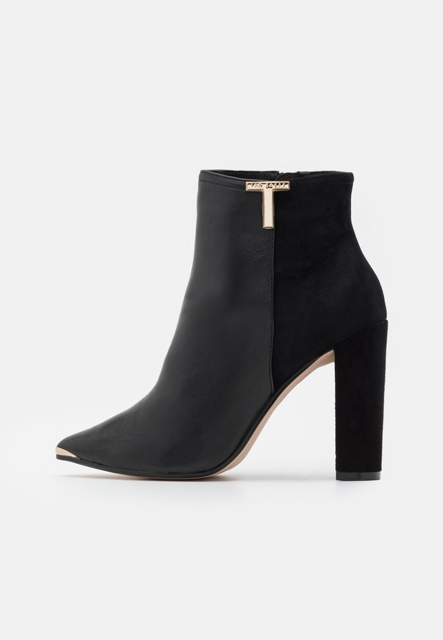 QINALA - High heeled ankle boots - black