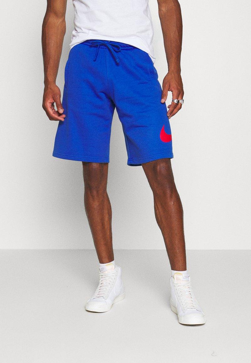 Nike Sportswear - Pantalones deportivos - game royal