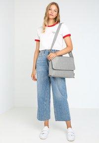Jost - Across body bag - light grey - 1