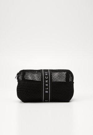TRAVEL BAG - Wash bag - black