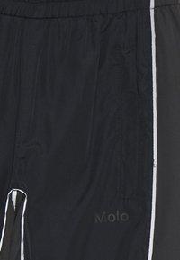 Molo - ARKUU - Tracksuit bottoms - black - 2