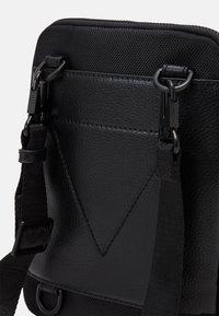 Guess - MASSA CONVERTIBLE CROSSBODY - Across body bag - black - 3