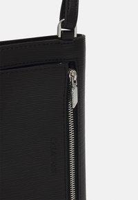 Calvin Klein - PHONE XBODY POUCH - Across body bag - black - 3