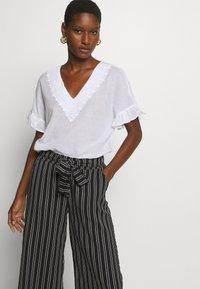 Cartoon - Trousers - black/white - 3