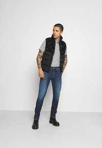 Calvin Klein Jeans - SLIM TAPER - Jeans Tapered Fit - blue - 1