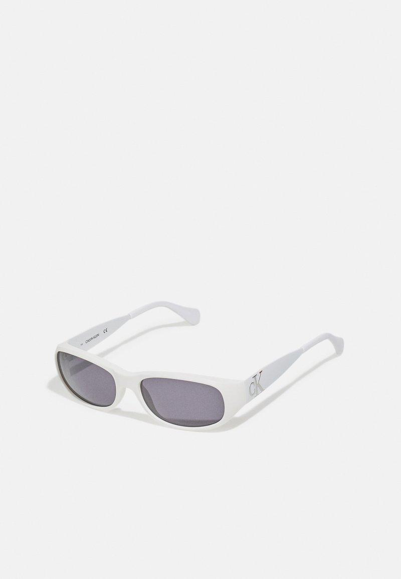 Calvin Klein - HERON PRESTON UNISEX - Sluneční brýle - chalk