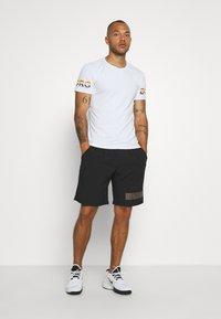 Björn Borg - MEDAL SHORTS - Sports shorts - black gold - 1