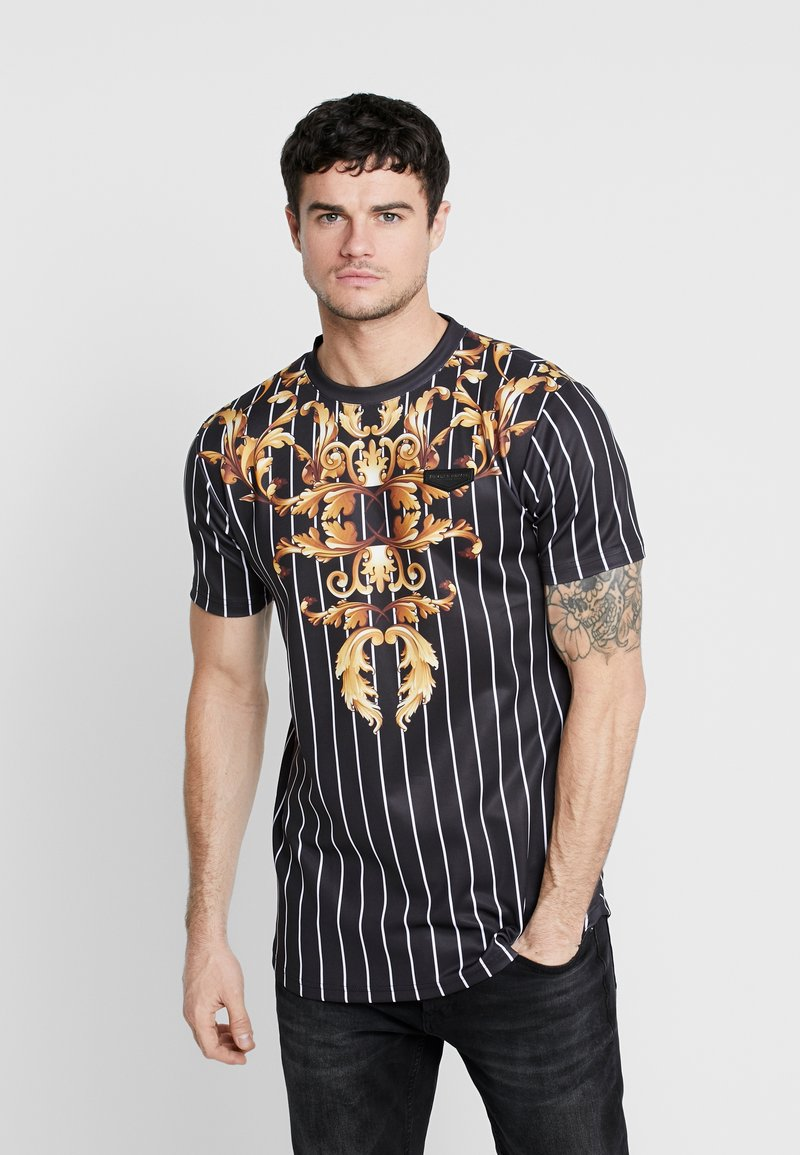 Supply & Demand - CADENCE - Print T-shirt - black/gold