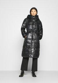 GAP - LONG PUFFER COAT - Winter coat - true black - 0