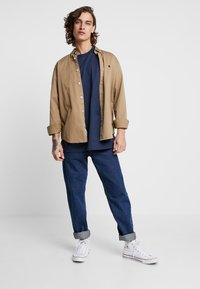 Carhartt WIP - NEWEL PANT MAITLAND - Relaxed fit jeans - blue stone washed - 1