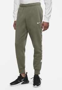 Nike Sportswear - REPEAT - Tracksuit bottoms - medium olive - 0