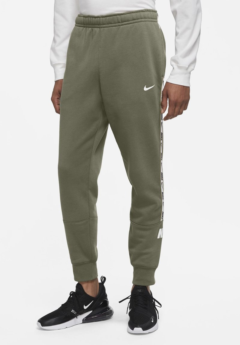 Nike Sportswear - REPEAT - Tracksuit bottoms - medium olive