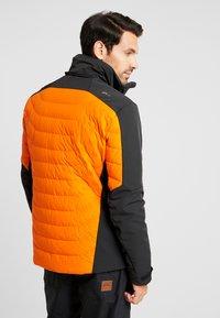 Kjus - MEN SIGHT LINE JACKET - Ski jacket - black/orange - 3