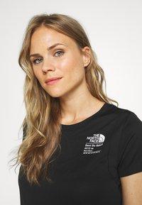 The North Face - GLACIER TEE - Print T-shirt - black - 3