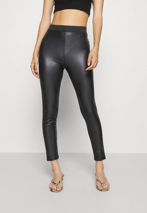 ONLCOCO - Leggings - Trousers - black