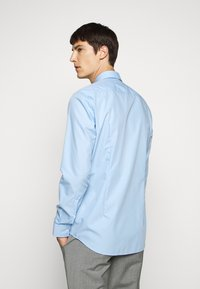 HUGO - KOEY - Formal shirt - light/pastel blue - 2