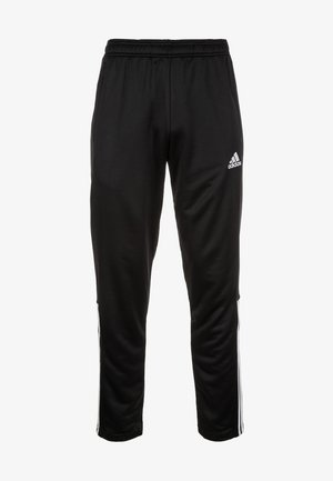 REGISTA 18 - Tracksuit bottoms - black / white