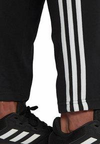 adidas Performance - Tracksuit bottoms - schwarz - 2