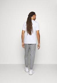 Calvin Klein Performance - Pantalon de survêtement - grey - 2