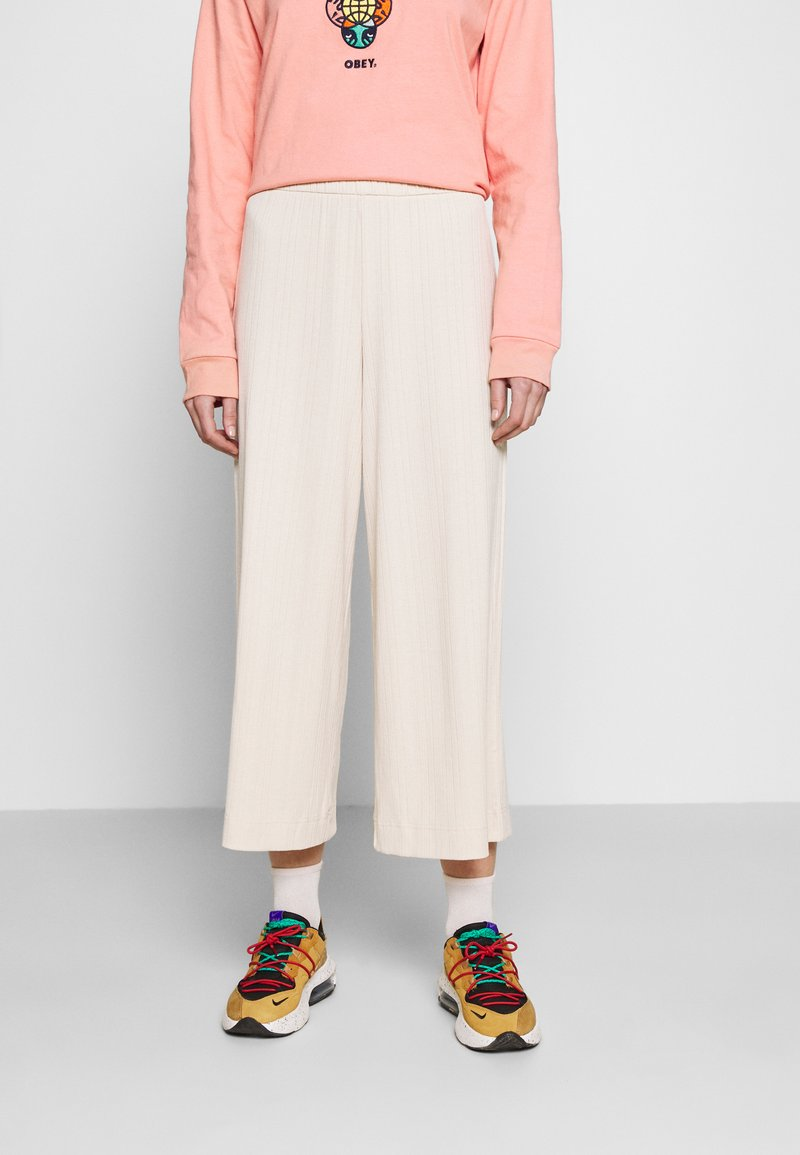 Monki - CILLA TROUSERS - Tracksuit bottoms - beige