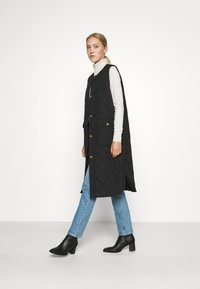 ONLY - ONLNAYRA LONG QUILT VEST - Waistcoat - black - 1