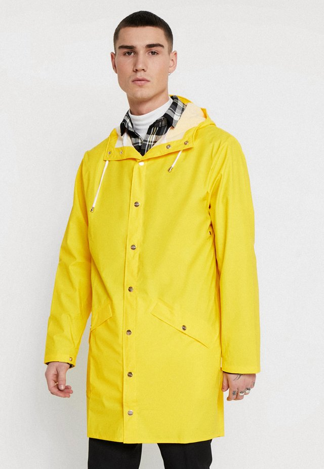LONG JACKET UNISEX - Waterproof jacket - yellow