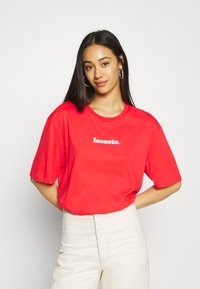 Lacoste - T-shirt print - energy red/white - 0