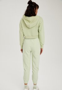 DeFacto - Tracksuit bottoms - green - 2