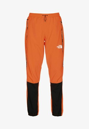 Tracksuit bottoms - black-shocking orange