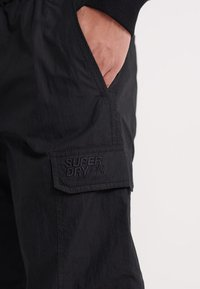 Superdry - UPERDRY NYCO PANTS - Cargo trousers - black - 3