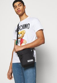 MOSCHINO - UNISEX - Across body bag - black - 0