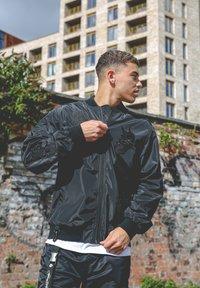 Ed Hardy - DRAG-CLOUD NYLON BOMBER JACKET - Summer jacket - black - 3