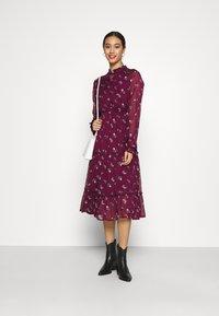 NA-KD - FRILL NECK MIDI DRESS - Day dress - dark red - 1