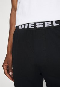 Diesel - UMLB-JULIO PANTALONI - Pyjama bottoms - black - 3
