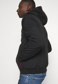 Tommy Jeans - PADDED JACKET - Light jacket - black - 4