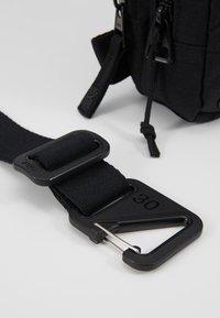 Nike Performance - KYRIE IRVING FESTIVAL BAG - Across body bag - black/dark smoke grey - 6