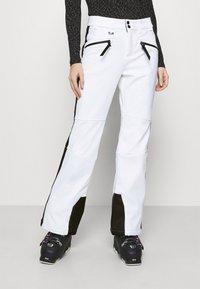 Superdry - SLALOM SLIM - Spodnie narciarskie - white - 0