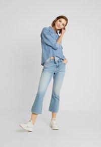 Tommy Jeans - CROP - Flared Jeans - light-blue - 1