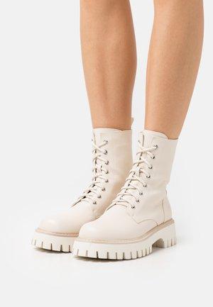 TALIA MAR VEGAN THE VOICES ARE ME - Platform ankle boots - beige