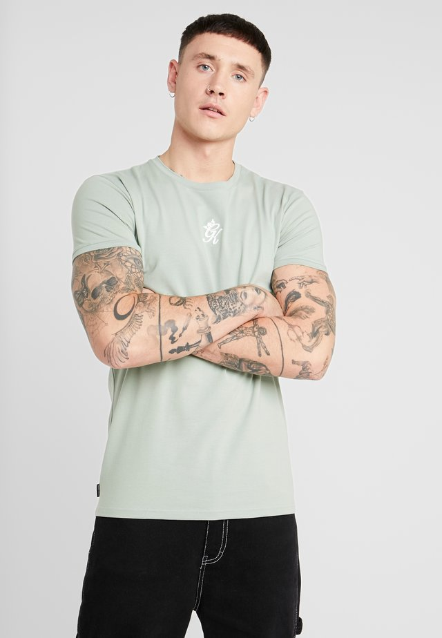 ORIGIN FITTED - Basic T-shirt - green mist