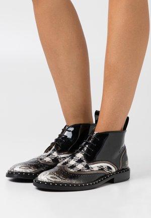 SALLY  - Lace-up ankle boots - black/white aztek/smoke black/white