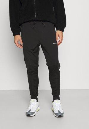 LOGO PANTS UNISEX - Tracksuit bottoms - black grey