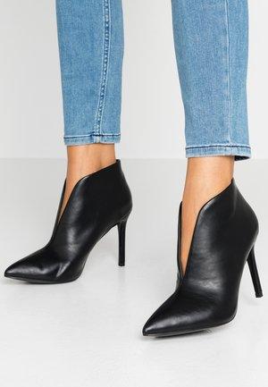 PUMPKIN - High heeled ankle boots - black