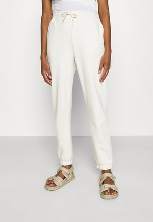 AMAZE - Tracksuit bottoms - off white
