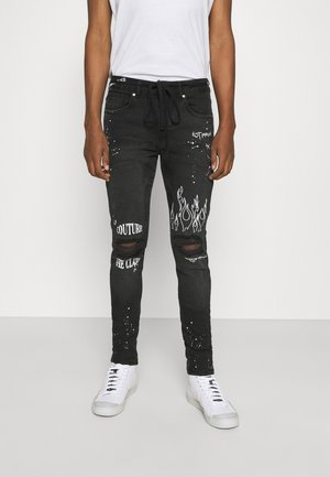 EMBROIDERED KNEE GRAFFITI - Jeans slim fit - black wash