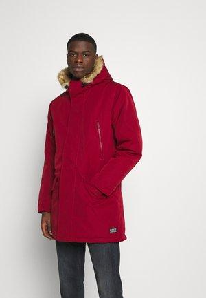 WOODSIDE LONG UTILITY  - Winter coat - biking red